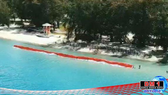 Reksa Wana UNG Gelar Napak Tilas: Bentangkan Merah-Putih 76 Meter di Pantai Bolihutuo